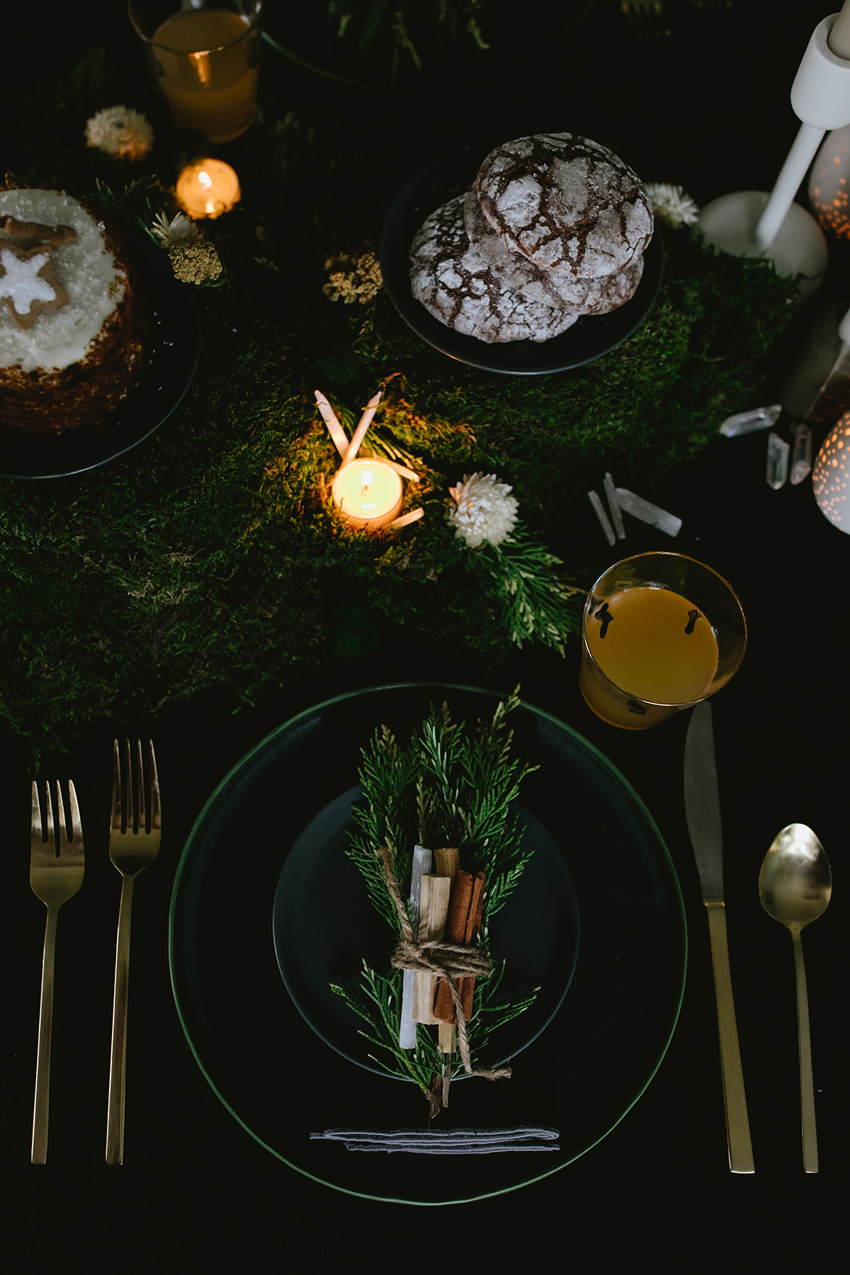 votives-tucked-into-moss-as-a-part-of-our-winter-solstice-tabletop